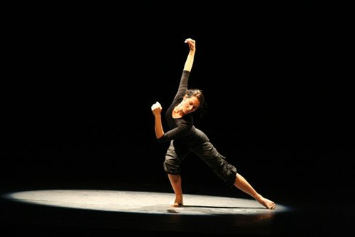 Martina Haager performing Manfred Aichinger's variation on a Hanna Berger solo during the 2006 Retouchings performance in Washington, DC. Lighting by Silvia Auer.