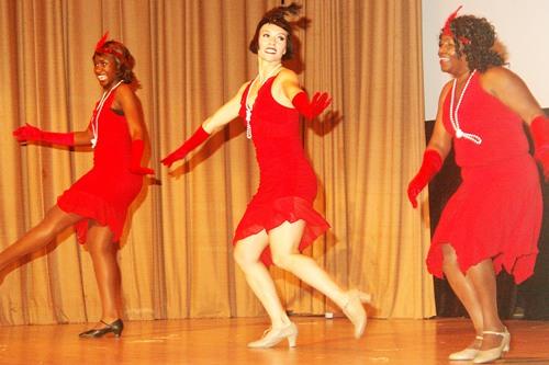 Atiya El-Amin, Beatriz Vasquez, and Adunni McPherson dance Charleston