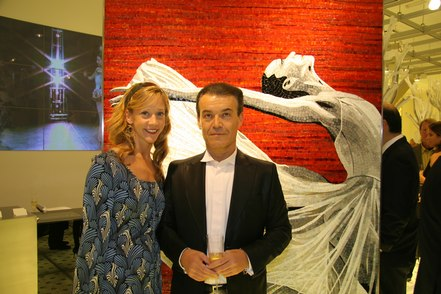 NYCB dancer Maria Kowroski with Maurizio Placuzzi in front of mosaic featuring Maria Kowroski