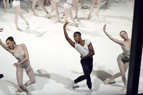 There were duet and trio moments within group work. This arm movement was used a lot in the choreography.