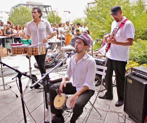 from left to right: Nestor Villar, timbales; David Freyre, bongos; Enrique Breton, bass.