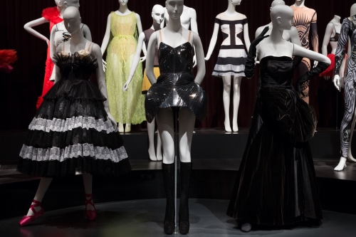 Installation view of Dance & Fashion, featuring (L to R), costume designs by Valentino Garavani, Iris van Herpen, and 'Cygne Noir' haute couture gown by Christian Dior. Photograph © The Museum at FIT, New York.