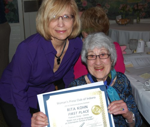 Rita Kohn (right) accepting her award from with Vivian Sade.