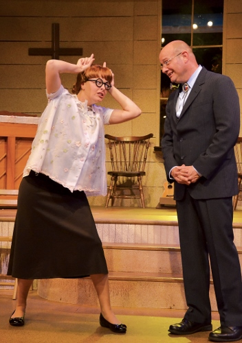 June upset with Mervin: June Sanders, now Mrs. Oglethorpe and eight months pregnant, berates her husband the Rev. Mervin Oglethorpe (John Vessels) in her unique sign language for having gone to the Blue Nose Tavern the night before in Beef & Boards Dinner Theatre's production of Smoke on the Mountain: Homecoming. This sequel in the popular bluegrass gospel series is on stage through Aug. 16. Tickets include Chef Odell Ward's dinner buffet.