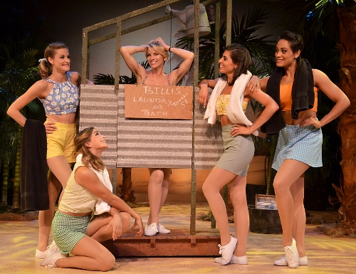 Nellie (Deb Wims), center, sings 'I'm Gonna Wash That Man Right Outa My Hair' with the nurses in Beef & Boards Dinner Theatre's production of South Pacific. The Rodgers & Hammerstein musical is now on stage through Oct. 4. Tickets include Chef Odell Ward's dinner buffet.