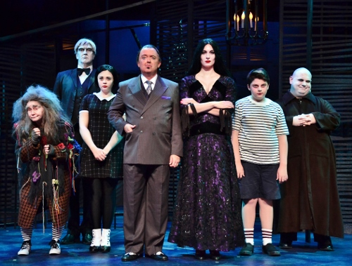 The Addams Family: The Addams Family (from left) Grandma (Amanda Butterbaugh), Lurch (Jeff Stockberger), Wednesday (Samantha Russell), Gomez (Eddie Curry), Morticia (Erin Cohenour), Pugsley (Simon Barnes) and Uncle Fester (Shaun Rice) is haunting the Beef & Boards Dinner Theatre stage now through Nov. 22.
