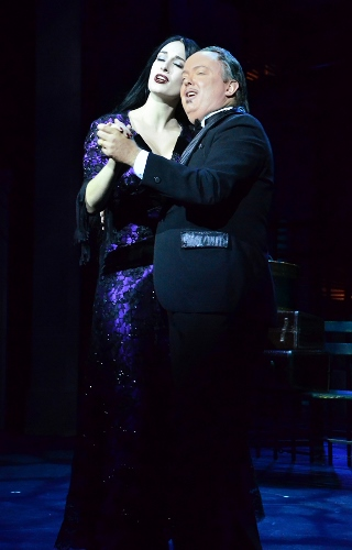 "Morticia (Erin Cohenour) and Gomez (Eddie Curry) Addams tango during ""Live Before We Die"" in Beef & Boards Dinner Theatre's production of the musical comedy The Addams Family, now on stage through Nov. 22."