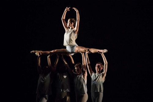"""Anna Barnes aloft with other IU Ballet Theater dancers in Twyla Tharp's """"Surfer at the River Styx."""""""