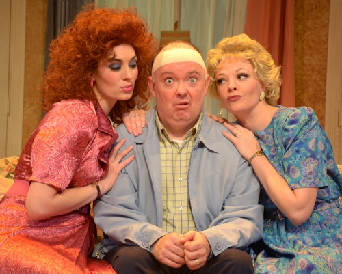 John Smith (Eddie Curry), center, seems like an ordinary cab driver, but he's leading a double life in Beef & Boards Dinner Theatre's production of Run for Your Wife. Married to both Barbara (Erin Cohenour), left, and Mary (Sarah Hund), right, John has been able to keep things in balance thanks to his precise schedule. But it all begins to unravel when that schedule gets disrupted one day, and John goes to great lengths to maintain wedded bliss with both of his wives – with hilarious results!
