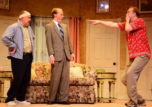 Stanley Gardner (Jeff Stockberger), right, is shocked as he realizes that his friend and neighbor John Smith (Eddie Curry), left, is implying to police Sergeant Troughton (A.J. Morrison), center, that the two men are in a relationship as a last-ditch effort to cover up Smith's double life in Beef & Boards Dinner Theatre's production of 'Run for Your Wife.'
