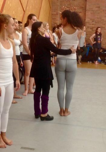 Choreographer Jacqulyn Buglisi assisting a dancer.