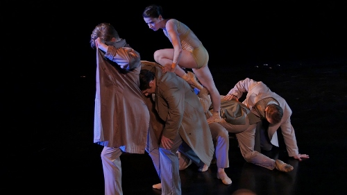 BalletMet's Caitlin Valentine-Ellis atop dancers in Atilla Bongar's 'Forced March: Second Eclogue.'