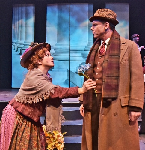 Eliza Doolittle (Kimberly Doreen Burns), left, tries to sell a flower to Professor Henry Higgins (David Schmittou) in Beef & Boards Dinner Theatre's production of My Fair Lady, now on stage through May 14. The Tony Award winning musical is returning to the Beef & Boards stage after a 20-year hiatus.
