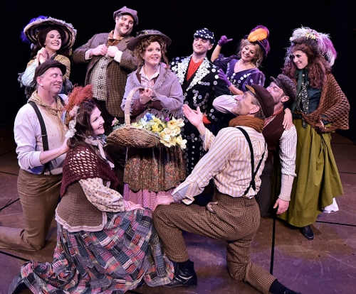 "Eliza Doolittle (Kimberly Doreen Burns), center, sings ""Wouldn't It Be Loverly"" in Beef & Boards Dinner Theatre's production of My Fair Lady, now on stage through May 14. The Tony Award winning musical is returning to the Beef & Boards stage after a 20-year hiatus."