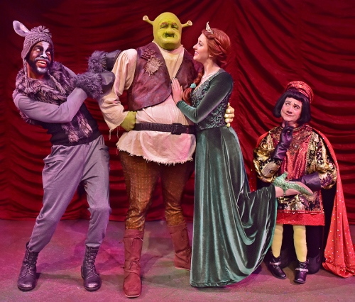 Funny Foursome: Now on stage at Beef & Boards Dinner Theatre, 'Shrek, The Musical' features (from left) Donkey (Julius Thomas III), Shrek (Peter Scharbrough), Princess Fiona (Emily Grace Tucker) and Lord Farquaad (John Vessels).