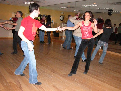 Erik Novoa and partner dance West Coast Swing