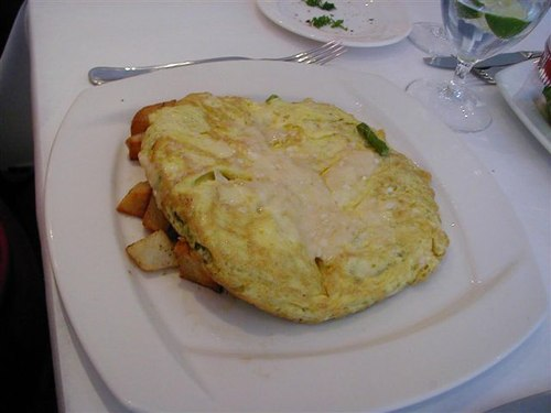 Frittata with Parmesan and Onions on Potatoes