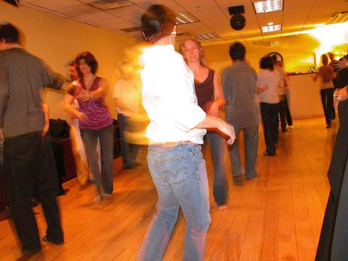 West Coast Swing dancers perfectly lined up