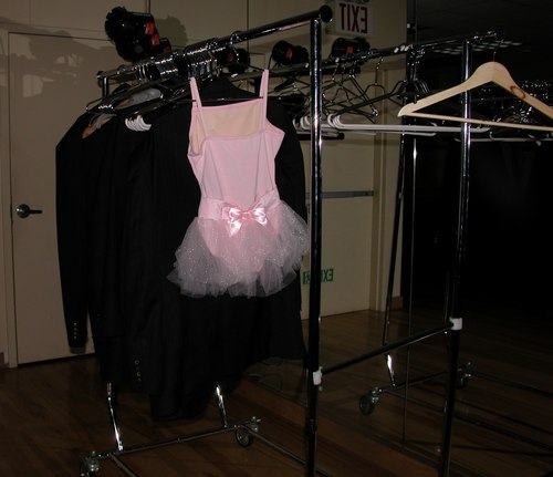 SparkleTutu, the successor to <a href='http://www.exploredance.com/list.htm?s=topic&sid=47'>PinkTop</a>, is a pink leotard with tutu liberally covered in rhinestones. SparkleTutu brightens up any room, even if most people wouldn't actually wear a tutu at a ballroom party (my 4 and a half year old neice might, though). SparkleTutu, and thousands of other dance clothing and shoes, are available at <a href='http://www.onstagedancewear.com'>OnStageDancewear.com</a>, a dance retailer providing friendly service whether you buy in their store or on the web. Watch ExploreDance.com for future appearances by SparkleTutu in all of the unexpected places we can think of.