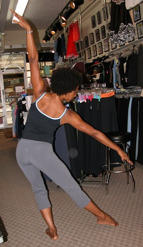 Black top with cornflower blue and grey trim. Grey pants. Clothing by AMMA. Modeled by Kendra Jackson. Available at <a href='http://www.onstagedancewear.com'>OnStageDancewear.com</a>.