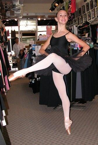 Black tutu by Sansha. Black cami leotard by Harmonie Bodywear. Modeled by Skylar Brandt. Available at <a href='http://www.onstagedancewear.com'>OnStageDancewear.com</a>.
