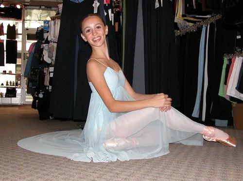 Aqua dress by OnStageDancewear.com. Modeled by Skylar Brandt. Available at <a href='http://www.onstagedancewear.com'>OnStageDancewear.com</a>.