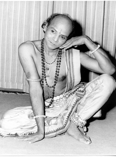 Guru Kelucharan Mohapatra one of the architects of modern Odissi dance, (teacher of the founder of Nrityagram, Protima Bedi) in a seated pose which captures lines of the feminine body.