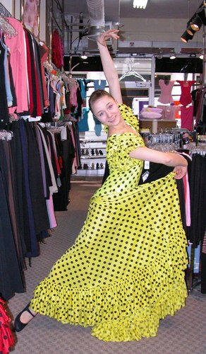 Cecilia is wearing a Yellow Sevillana Flamenco Dress, Style DW899Y, by Star Styled Joanna Designs, $169.95; and Black Ball*Pilmar Flamenco Shoes, Style 523, Distributed by Freed of London, $129.95. Available at <a href='http://www.onstagedancewear.com'>OnStageDancewear.com</a>.