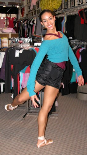Kimberly is wearing Black Bloomers Pants, Body Wrappers, Style 746, $19.99; Cross Over Neck Leotard, Color GNT, Style P500 from the Premiere Collection by Body Wrappers, $39.99; and a Green, Echauffement from the Knits Collection by Sansha, Style K5406, $39.99. Available at <a href='http://www.onstagedancewear.com'>OnStageDancewear.com</a>.