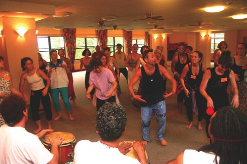 Drumming in the yoga dance class