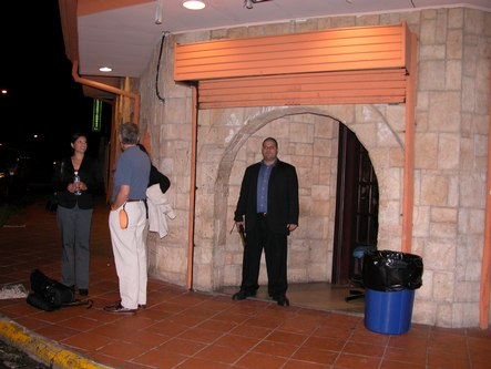 The exterior of Castro's Bar, with security person