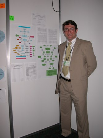 Robert Abrams with his poster, 'Teaching Concept Mapping as Assessment to Teacher Candidates - Some Successes and a Proposal for Next Steps'