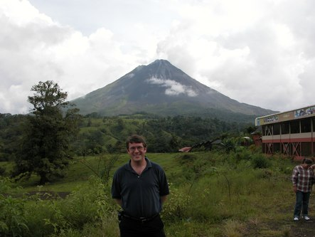 Robert Abrams with Arenal Volcano in the distance
