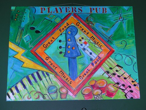 Great Food Great Music: mural on the wall above Players Pub dance floor (Carol Miller created the murals for Players Pub)