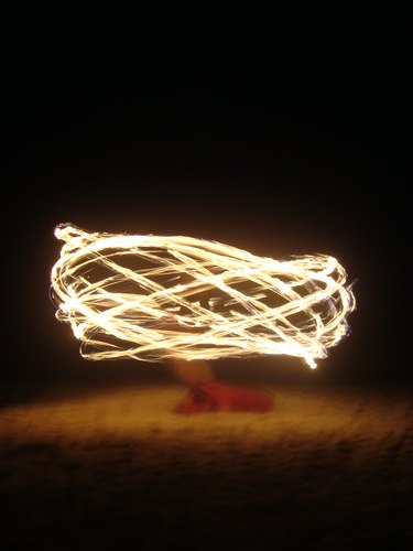 The Fuego Rojo dancers playing with fire on the beach