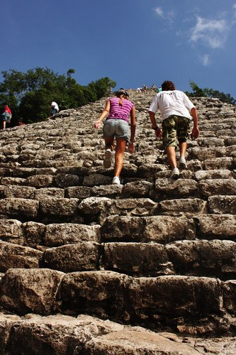 Visitors head to the top of an ancient Mayan pyramid